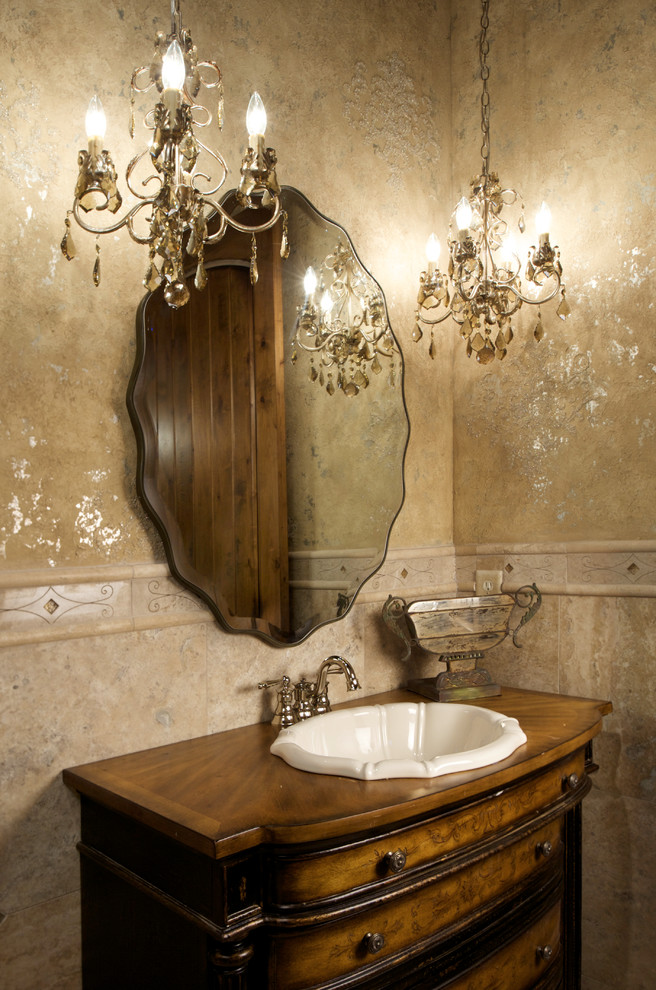 Example of a classic beige tile powder room design in Kansas City with a drop-in sink, furniture-like cabinets, medium tone wood cabinets, wood countertops and brown countertops