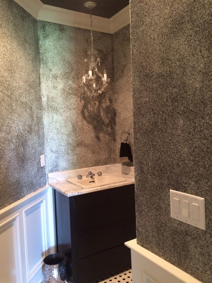 Inspiration for a mid-sized timeless powder room remodel in Cincinnati with black cabinets, gray walls, a drop-in sink and marble countertops