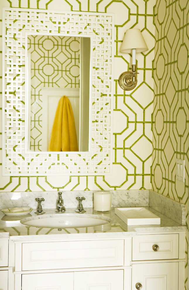 Powder room - traditional powder room idea in Los Angeles with marble countertops