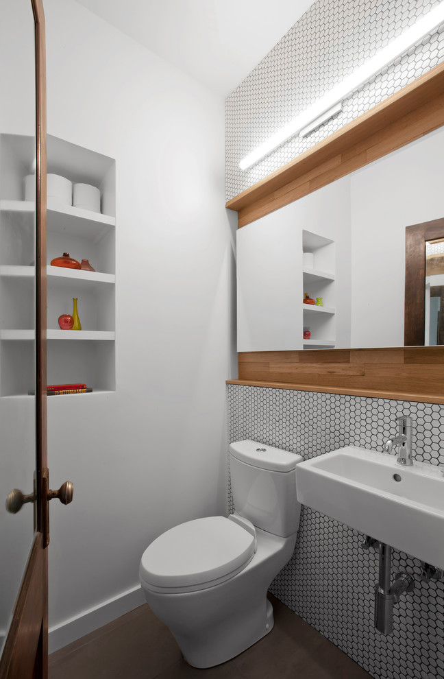 Powder room - mid-sized transitional white tile and mosaic tile porcelain tile and brown floor powder room idea in Indianapolis with a two-piece toilet, white walls and a wall-mount sink
