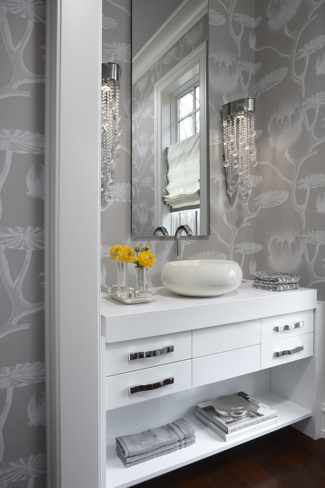Example of a trendy powder room design in Detroit with a vessel sink
