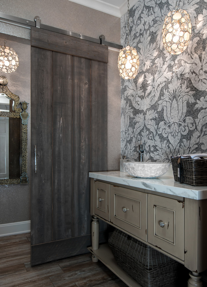 Powder room - traditional dark wood floor powder room idea in Detroit with a vessel sink, furniture-like cabinets, gray walls and distressed cabinets