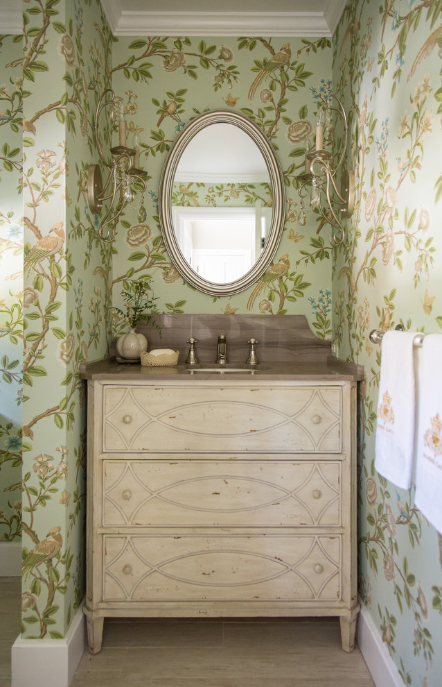 Powder room - shabby-chic style ceramic tile powder room idea in Los Angeles with an undermount sink, furniture-like cabinets, light wood cabinets, green walls, marble countertops and brown countertops