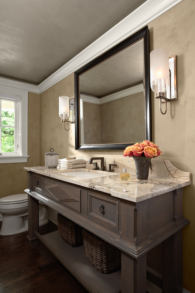 Elegant powder room photo in Minneapolis with an undermount sink, open cabinets, dark wood cabinets and beige countertops