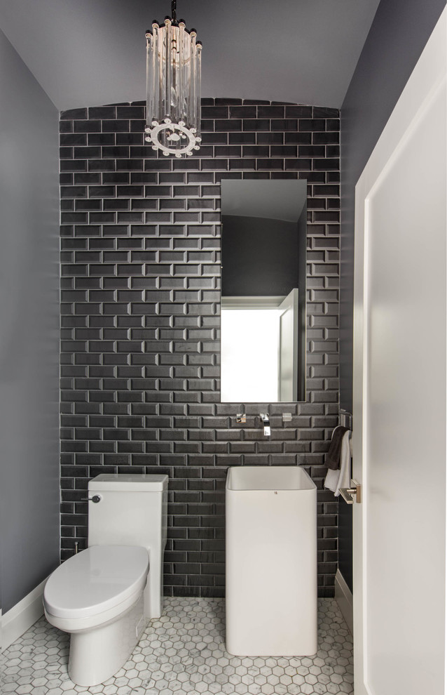 Powder room - small contemporary gray tile, black tile, white tile and subway tile mosaic tile floor powder room idea in Toronto with a pedestal sink, a two-piece toilet and gray walls