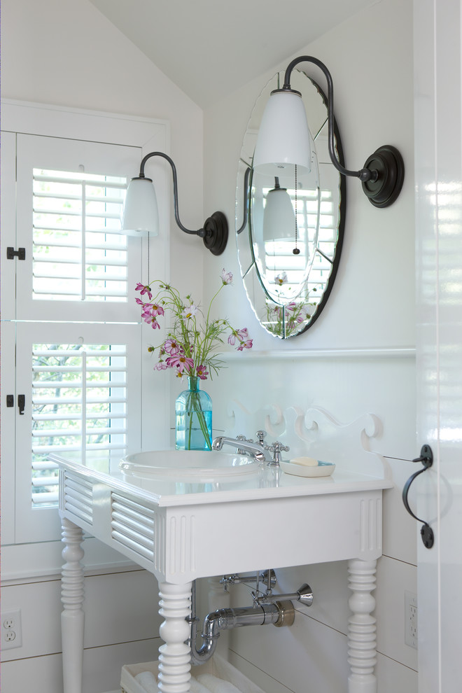 Inspiration for a small coastal white tile porcelain tile and beige floor powder room remodel in Boston with open cabinets, white cabinets, white walls, a console sink and solid surface countertops