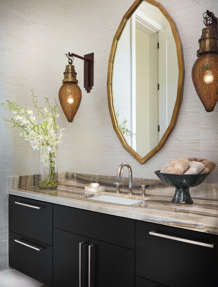 Powder room - contemporary powder room idea in Denver with black cabinets, an undermount sink, onyx countertops, flat-panel cabinets and beige walls