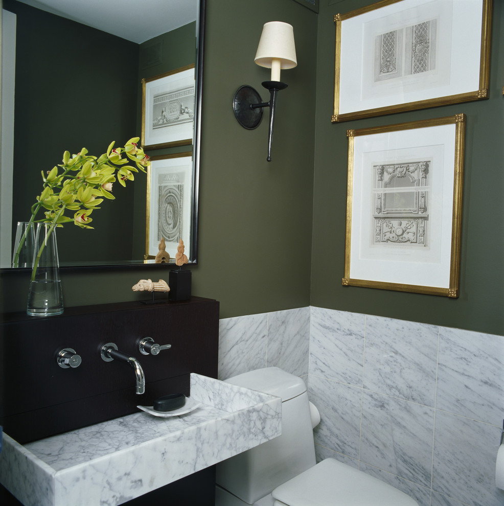 Inspiration for a contemporary marble tile powder room remodel in Chicago with a wall-mount sink