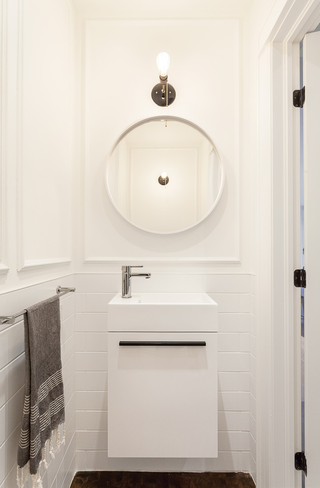 Example of a small trendy white tile and subway tile dark wood floor and brown floor powder room design in Ottawa with an integrated sink, flat-panel cabinets, white cabinets and white walls