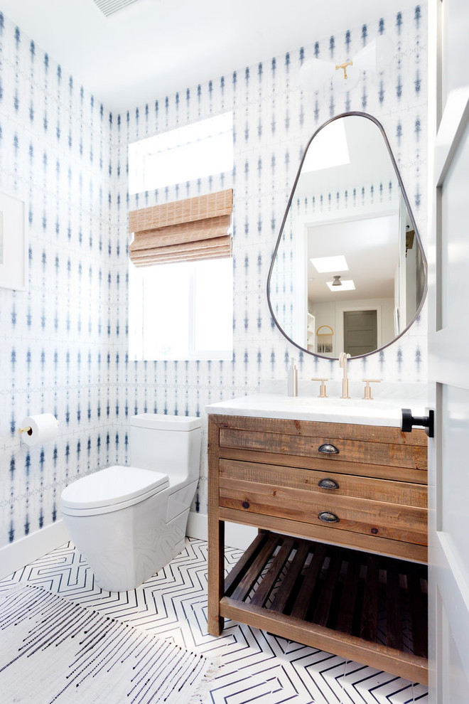 Inspiration for a transitional powder room remodel in San Francisco with furniture-like cabinets, medium tone wood cabinets and multicolored walls