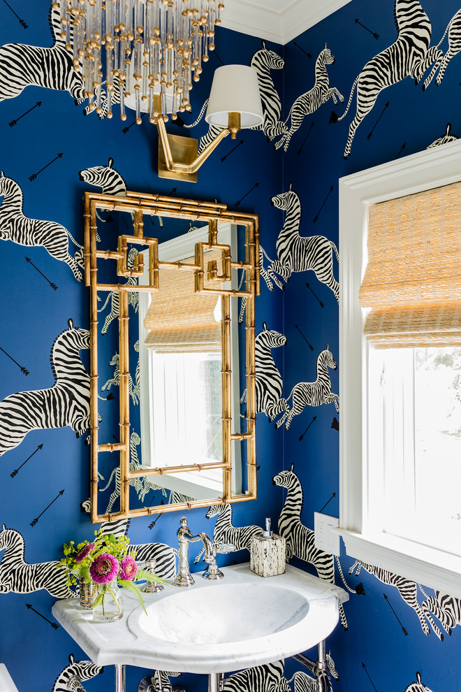Inspiration for a transitional powder room remodel in San Francisco with a console sink and blue walls
