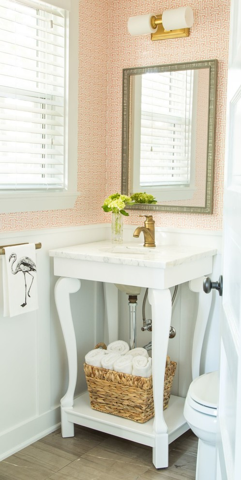 Inspiration for a transitional powder room remodel in Boston with white countertops