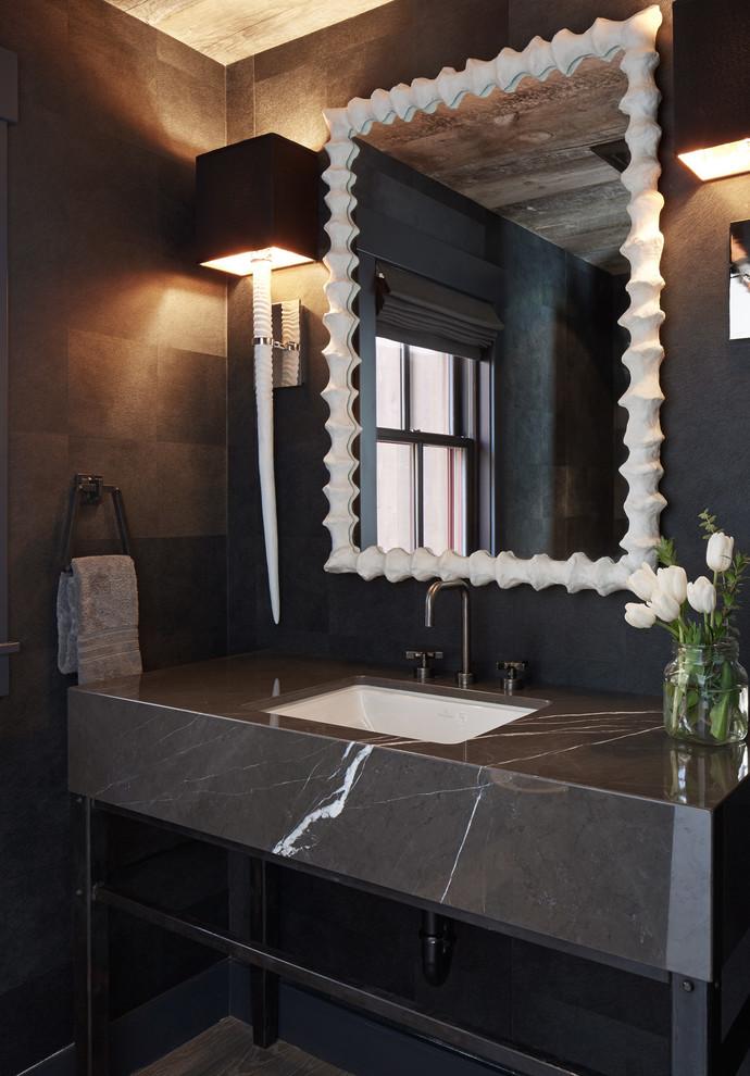 Esempio di un bagno di servizio minimal con lavabo sottopiano, top in marmo e top grigio
