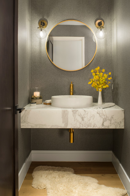 Example of a transitional medium tone wood floor and brown floor powder room design in Denver with gray walls and a vessel sink