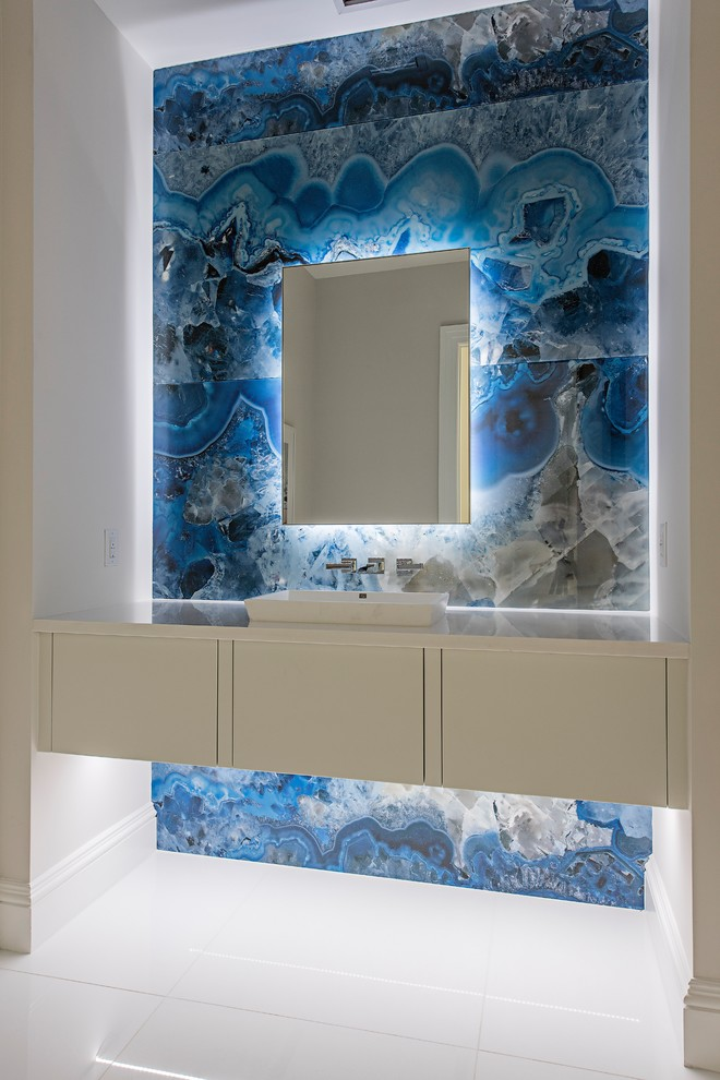 Trendy white floor powder room photo in Minneapolis with flat-panel cabinets, white cabinets, multicolored walls, a vessel sink and white countertops