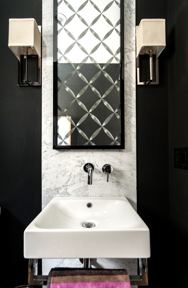 Trendy marble tile powder room photo in Toronto with a wall-mount sink