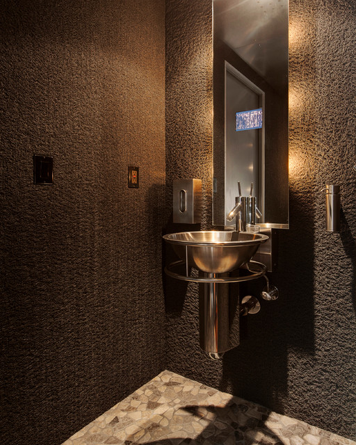 Trendy powder room photo in San Francisco with a vessel sink