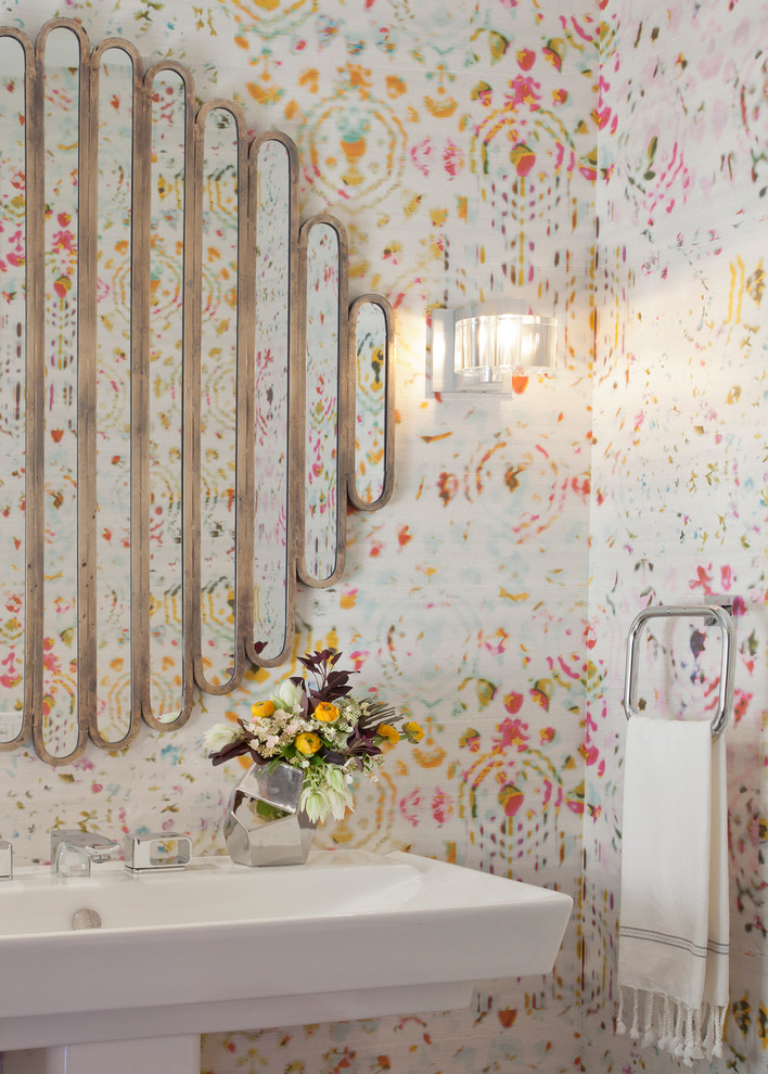 Powder room - contemporary powder room idea in Chicago with a pedestal sink and multicolored walls