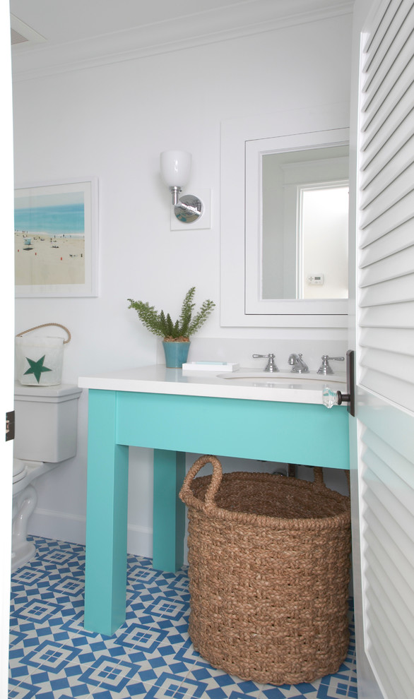 Mid-sized beach style blue tile cement tile floor and multicolored floor powder room photo in San Diego with an undermount sink, blue cabinets, quartz countertops, white walls, a two-piece toilet and white countertops