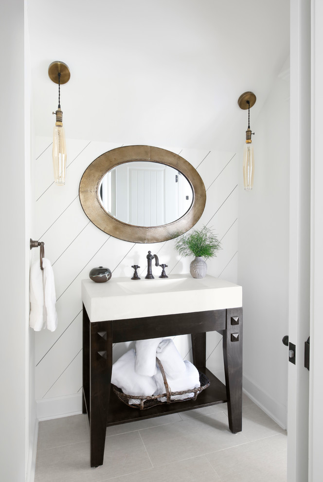 Powder room - country gray floor powder room idea with white walls, a console sink and white countertops