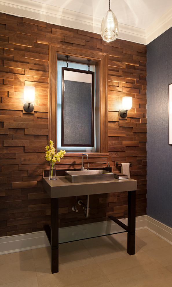 Mid-sized beach style brown tile limestone floor powder room photo in Chicago with concrete countertops, a vessel sink and blue walls