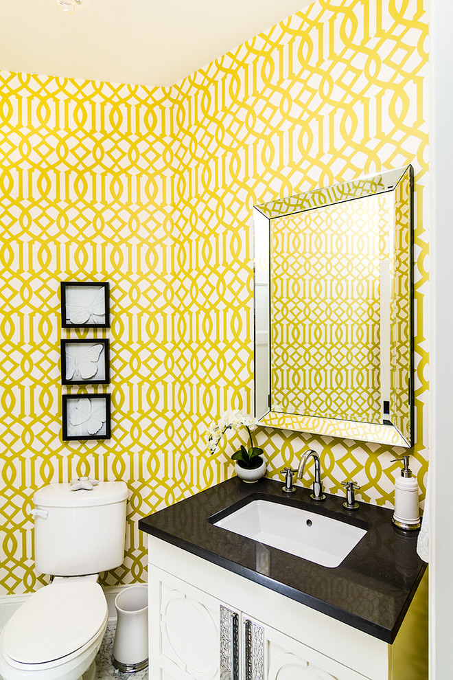 Powder room - traditional powder room idea in Other with an undermount sink and white cabinets