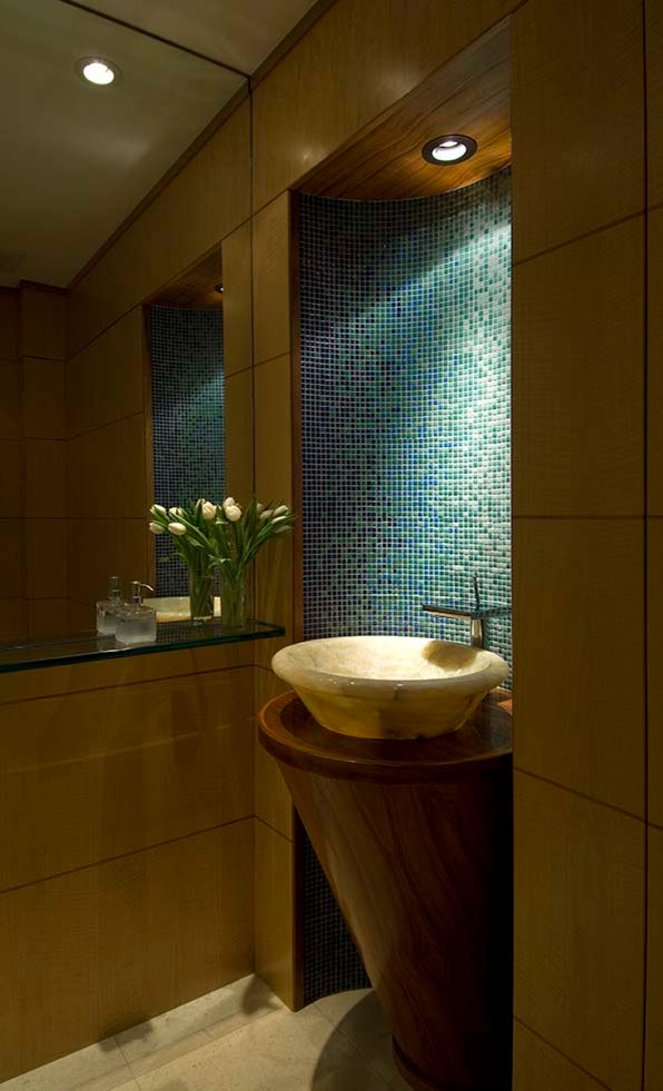 Inspiration for a small contemporary blue tile, green tile and mosaic tile ceramic tile and beige floor powder room remodel in Hawaii with flat-panel cabinets, medium tone wood cabinets, brown walls, a vessel sink, wood countertops and brown countertops