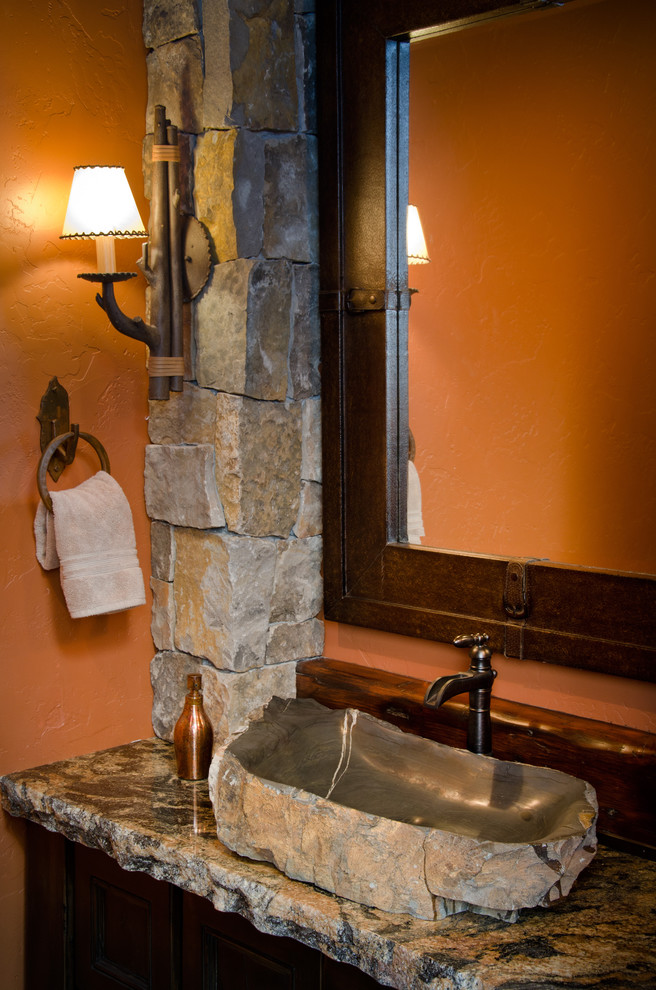 Powder room - large rustic powder room idea in Other with granite countertops, orange walls and a vessel sink