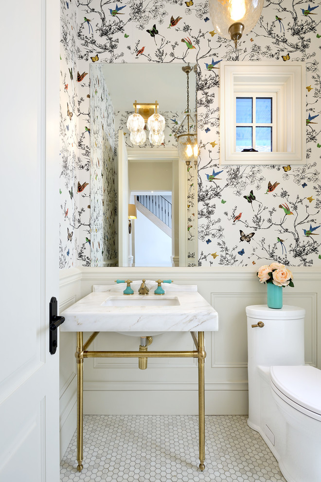 Small elegant marble floor and white floor powder room photo in Toronto with a one-piece toilet, multicolored walls, a console sink, furniture-like cabinets and marble countertops