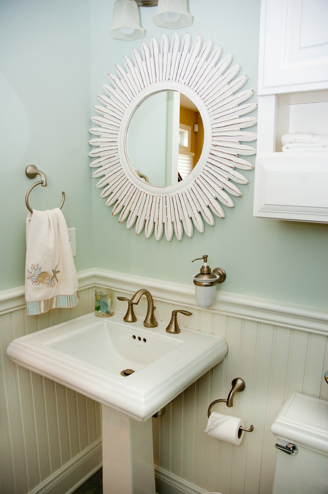 Beach style powder room photo in New York with a pedestal sink