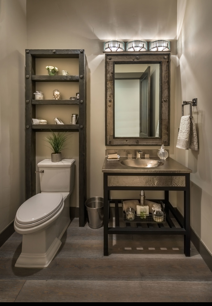 Mountain style dark wood floor powder room photo in Other with furniture-like cabinets and beige walls