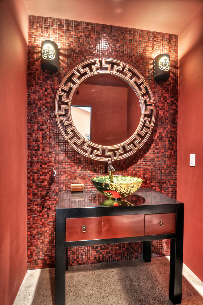 Powder room - mid-sized red tile and mosaic tile concrete floor powder room idea in Orange County with a vessel sink, red walls, furniture-like cabinets and red cabinets