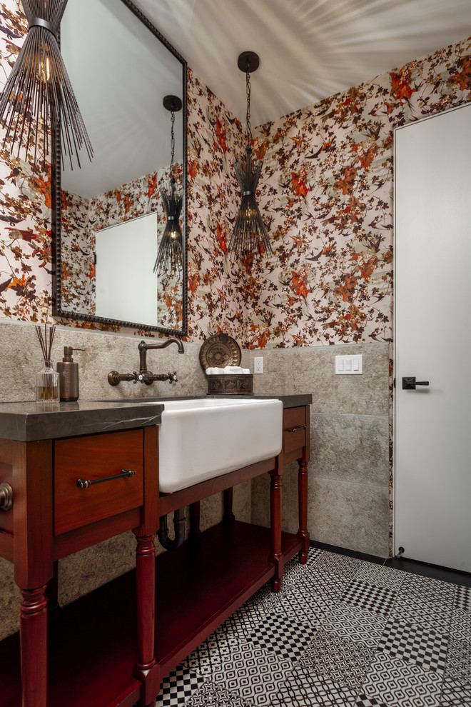 Powder room - eclectic gray tile black floor powder room idea in Las Vegas with flat-panel cabinets, dark wood cabinets, multicolored walls, a drop-in sink and gray countertops