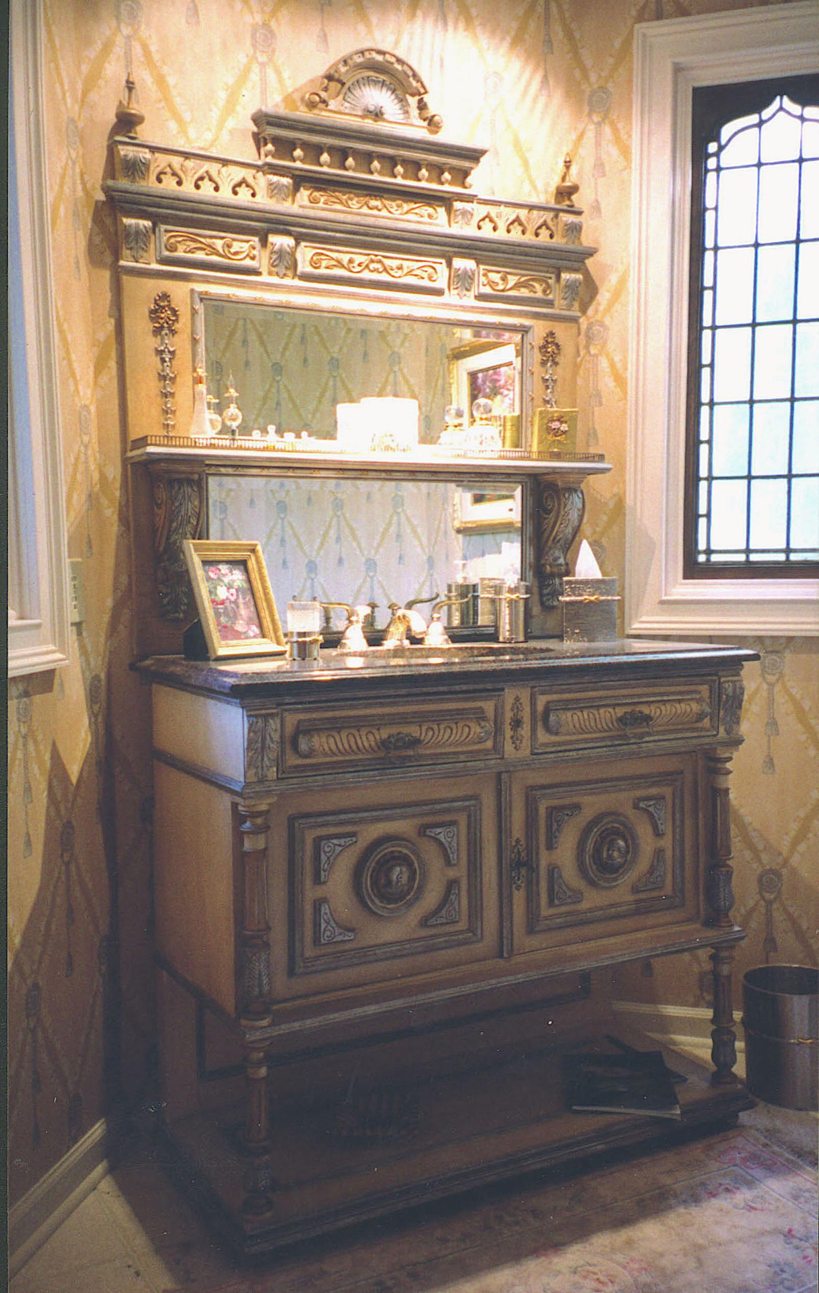 Exotic Finishes.Powder room custom vanity