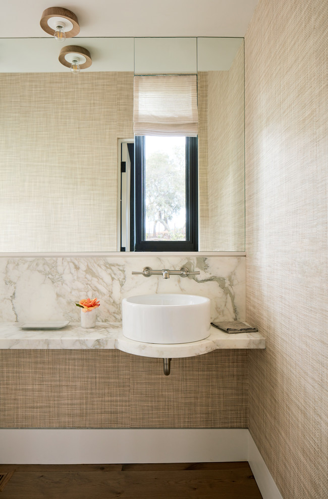 Photo of a country powder room in San Francisco with white tile, beige walls, a vessel sink, marble benchtops and medium hardwood floors.