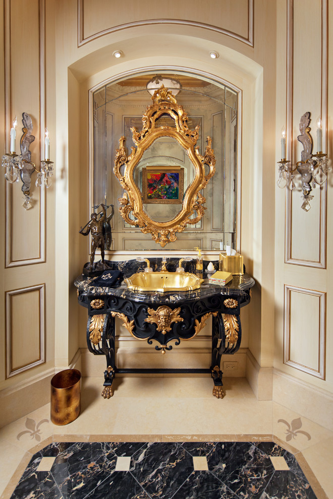 Example of a mid-sized tuscan marble floor powder room design in Chicago with a drop-in sink, furniture-like cabinets, black cabinets, a one-piece toilet and beige walls