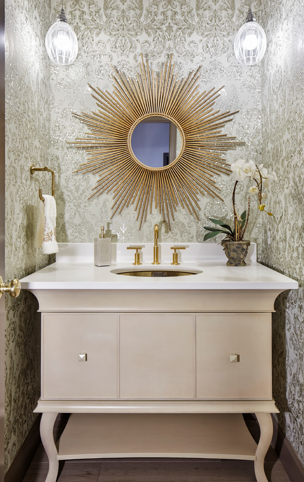 Example of a small transitional powder room design in Denver with an undermount sink, furniture-like cabinets, beige cabinets, multicolored walls and white countertops
