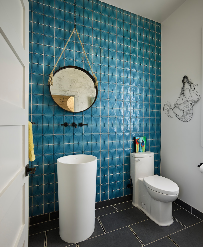 Inspiration for a small coastal blue tile and glass tile gray floor powder room remodel in San Francisco with a one-piece toilet, blue walls, a pedestal sink and white cabinets