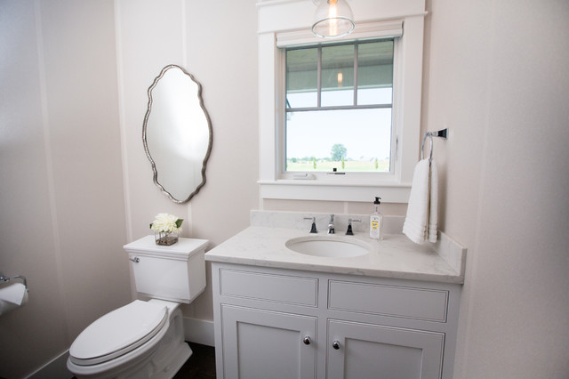 Example of a mid-sized transitional white tile and ceramic tile porcelain floor and gray floor powder room design in Other with shaker cabinets, white cabinets, a two-piece toilet, white walls, an undermount sink and engineered quartz countertops