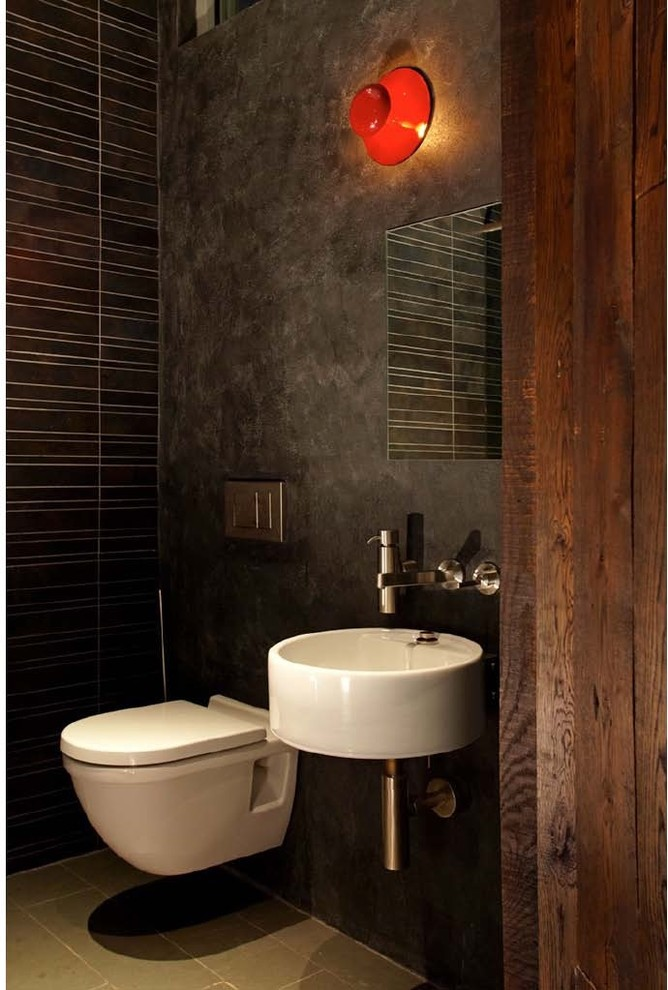 Inspiration for an industrial powder room remodel in New York with a wall-mount sink and a wall-mount toilet