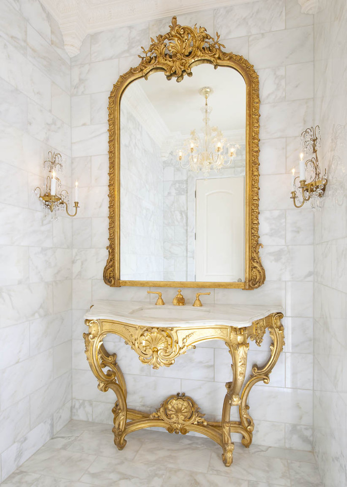 Elegant marble tile powder room photo in Dallas with an undermount sink