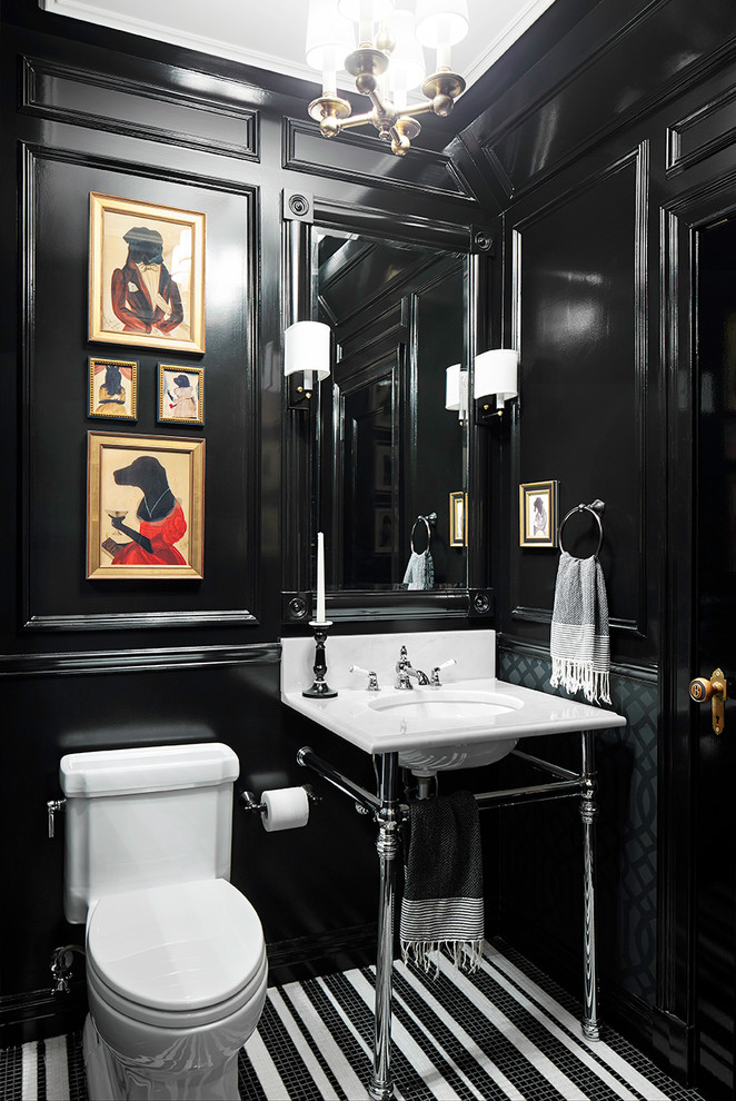 Elegant mosaic tile floor powder room photo in New York with a console sink, a one-piece toilet and black walls