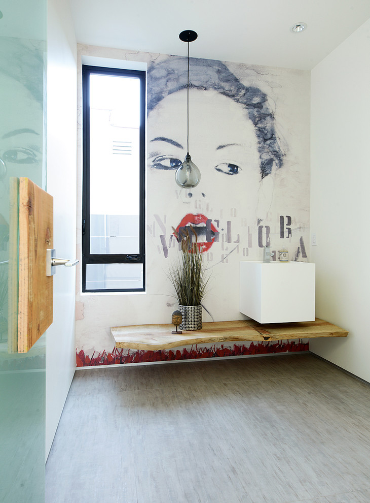 Powder room - contemporary powder room idea in Los Angeles with a wall-mount sink and white walls