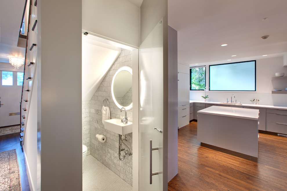 Trendy gray tile and stone tile powder room photo in Austin with a wall-mount sink