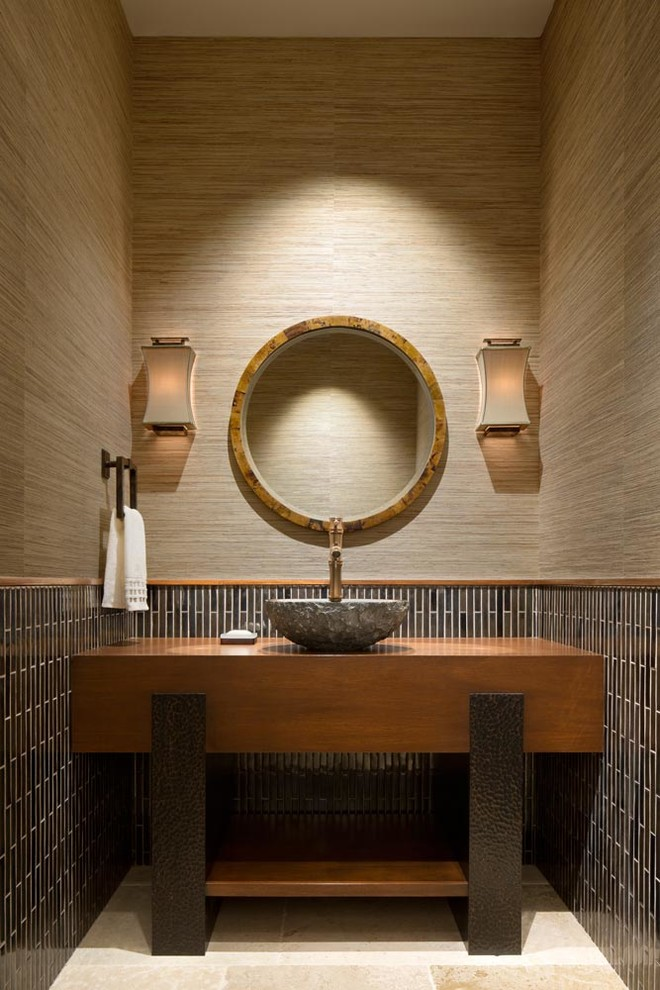 Powder room - contemporary brown tile and matchstick tile beige floor powder room idea in Miami with open cabinets, medium tone wood cabinets, brown walls and a vessel sink