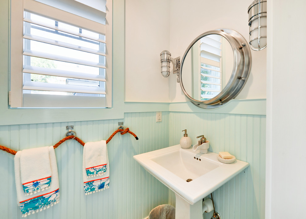 Inspiration for a beach style powder room remodel in Philadelphia with a pedestal sink