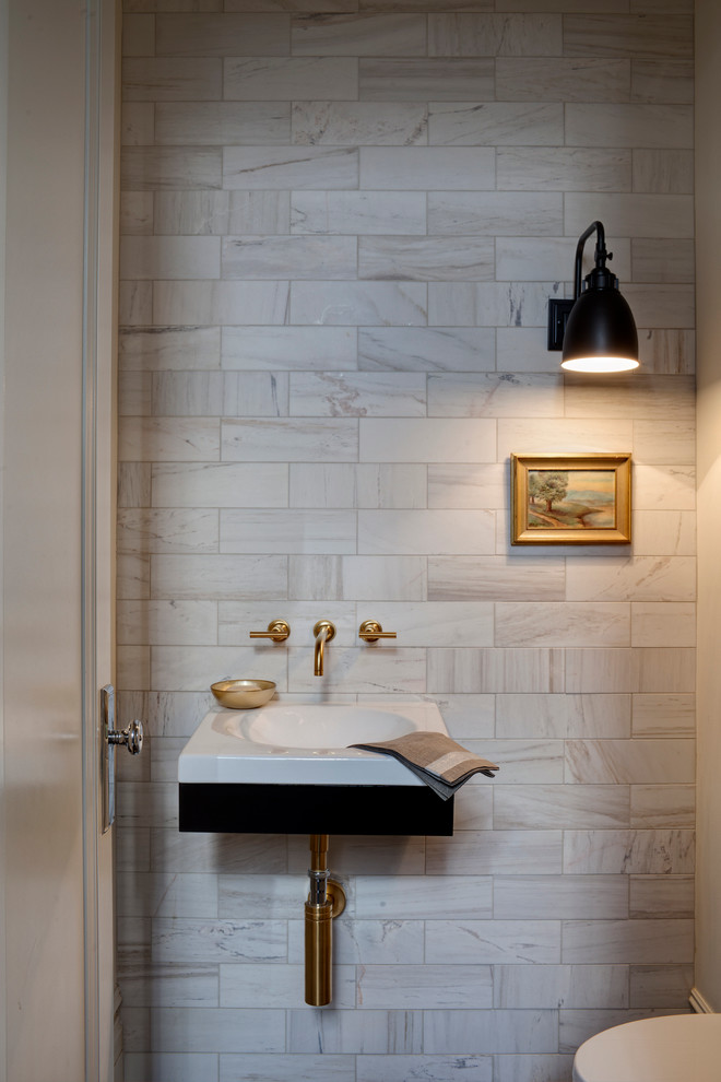 Example of a transitional marble tile powder room design in Chicago with a wall-mount sink