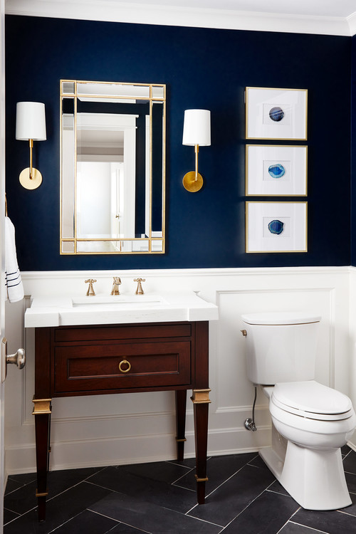The addiiton of navy walls to an otherwise white bathroom is an instant classic.