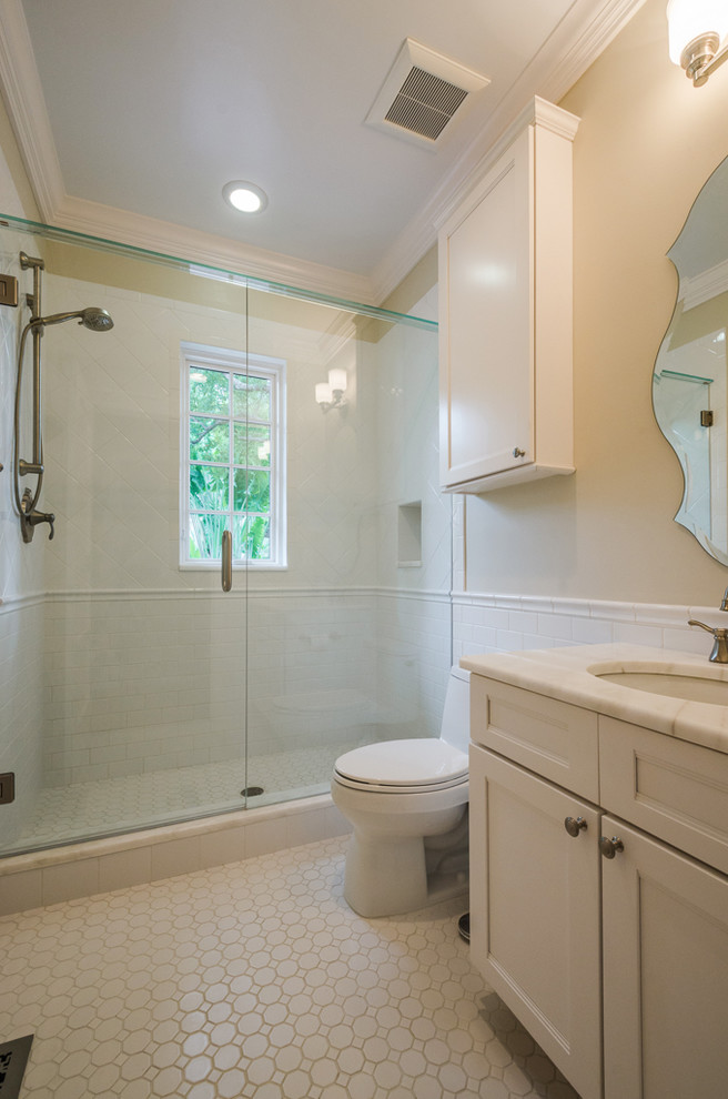 Inspiration for a timeless powder room remodel in Tampa