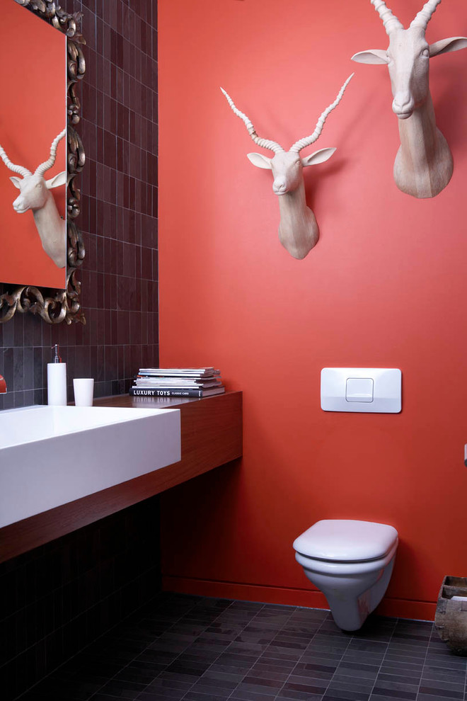 Inspiration for a contemporary powder room remodel in Toronto with a wall-mount toilet
